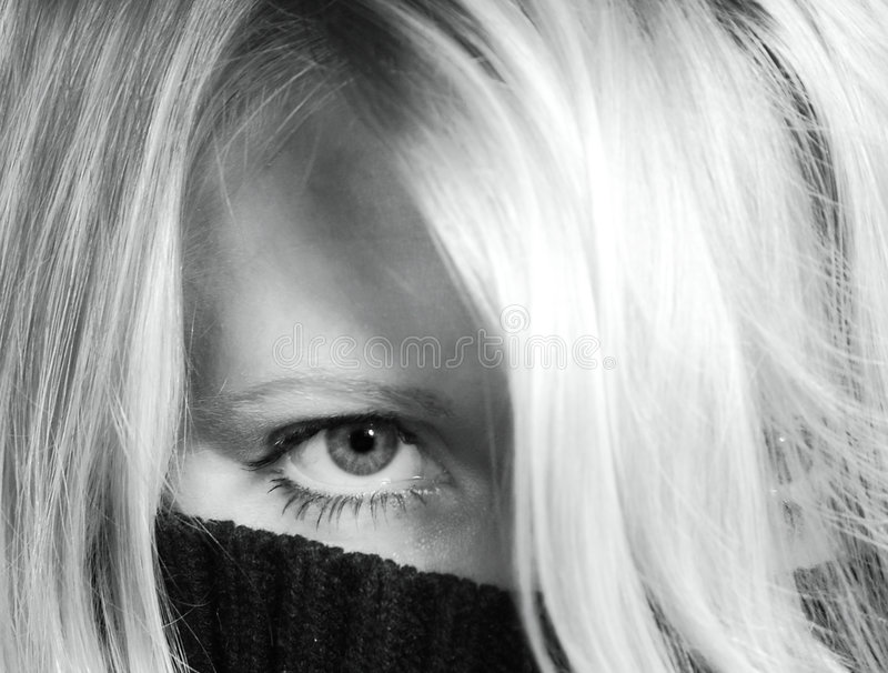 Hidden woman. Close up of a woman behind a pullover royalty free stock photography