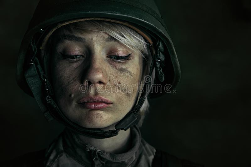 Portrait of young female soldier. Hide the best of yourself for getting proud. Close up portrait of young female soldier. Woman in military uniform on the war stock photos