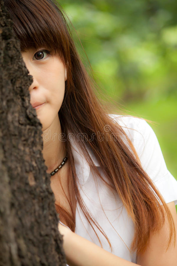 Hide and seek. Young asian woman playing hide and seek royalty free stock photos