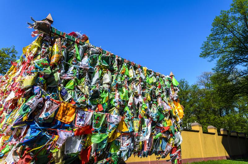 Buddhist datsan, a lot of handkerchiefs tied in a religious place. a place of prayer and worship. Hideki in a Buddhist datsan, a lot of handkerchiefs tied in a royalty free stock photo