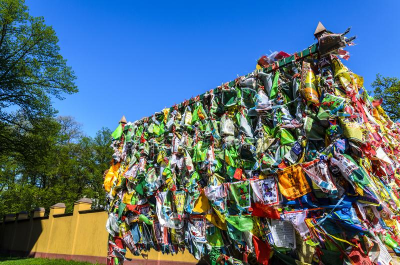 Hideki in a Buddhist datsan, a lot of handkerchiefs tied in a religious place. a place of prayer. And worship royalty free stock photo