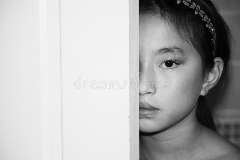 Hiding Child-Book Cover. Child hiding behind a door