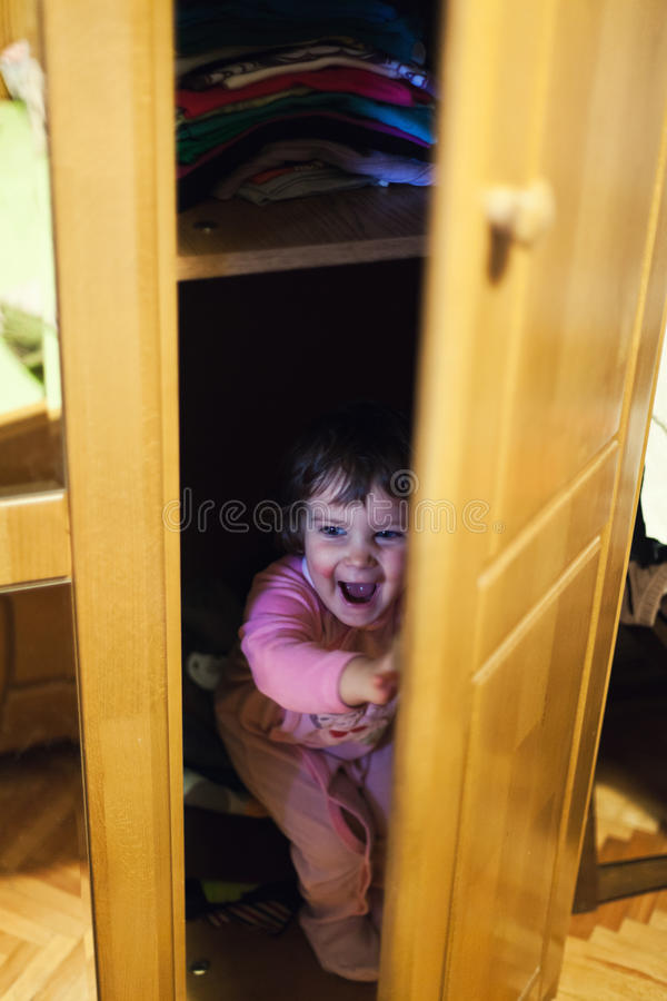 Hiding in closet stock photo. Image of discovered, mood