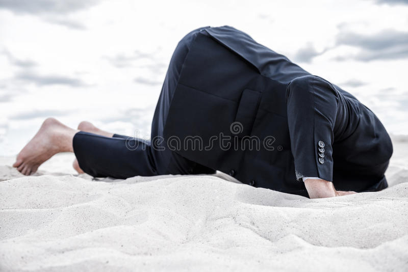 Hiding from his problems. stock photo
