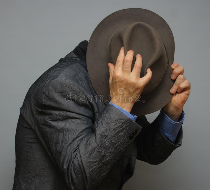 Hiding man stock photos