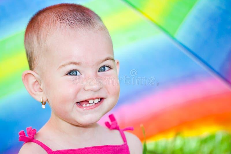 Hiding Under A Colorful Umbrella Stock Photos