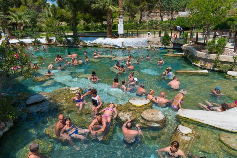 People swimming in the Cleopatra`s thermal pool in Pamukkale, Turkey stock photos