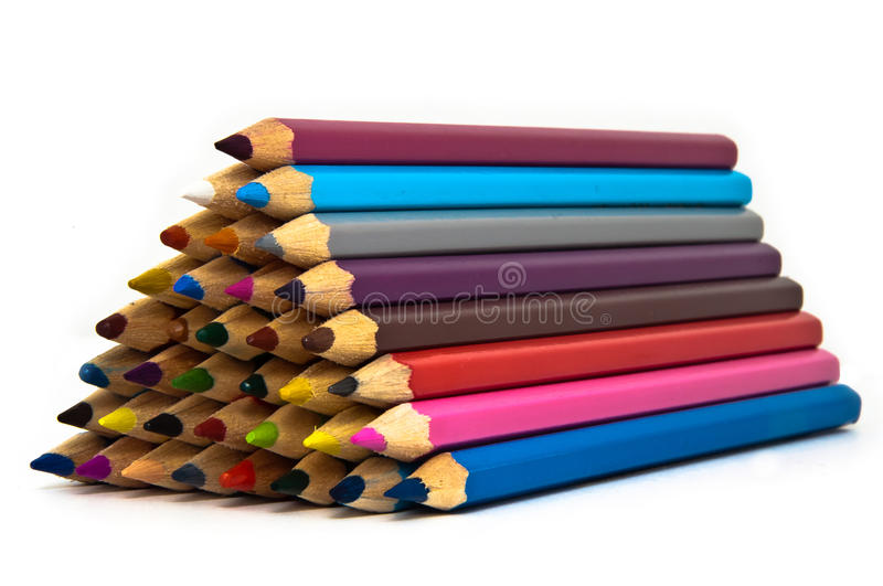 Hierarchy. Shown by a tower of crayons stock image