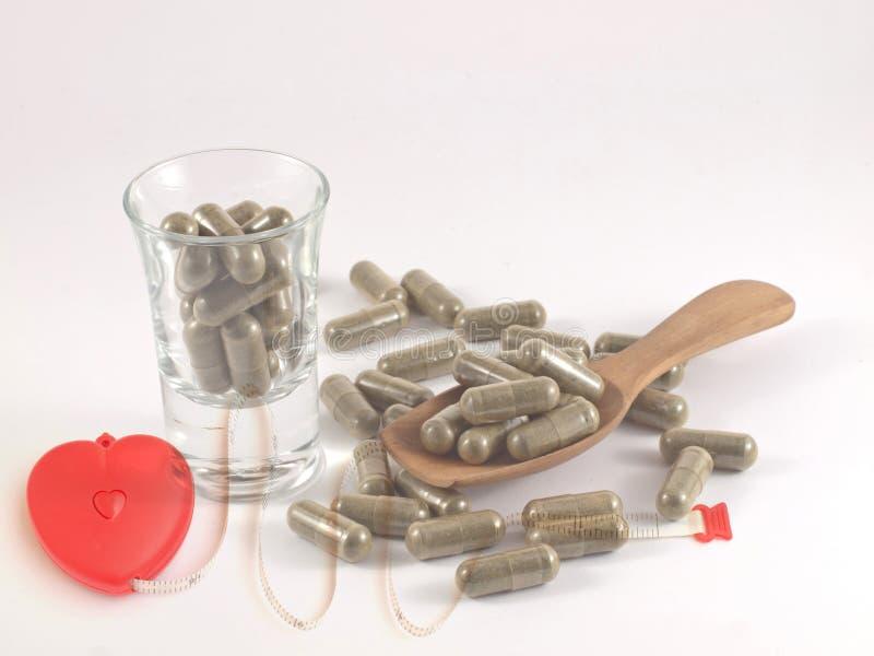 Hierba en píldora de la cápsula imagen de archivo