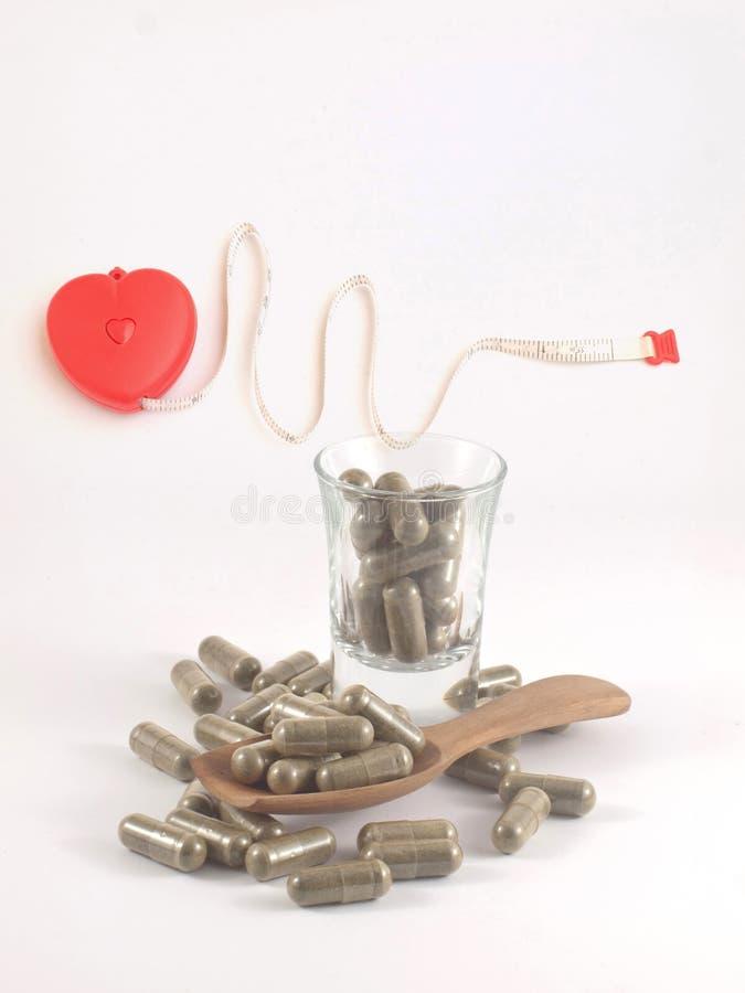 Hierba en píldora de la cápsula fotos de archivo
