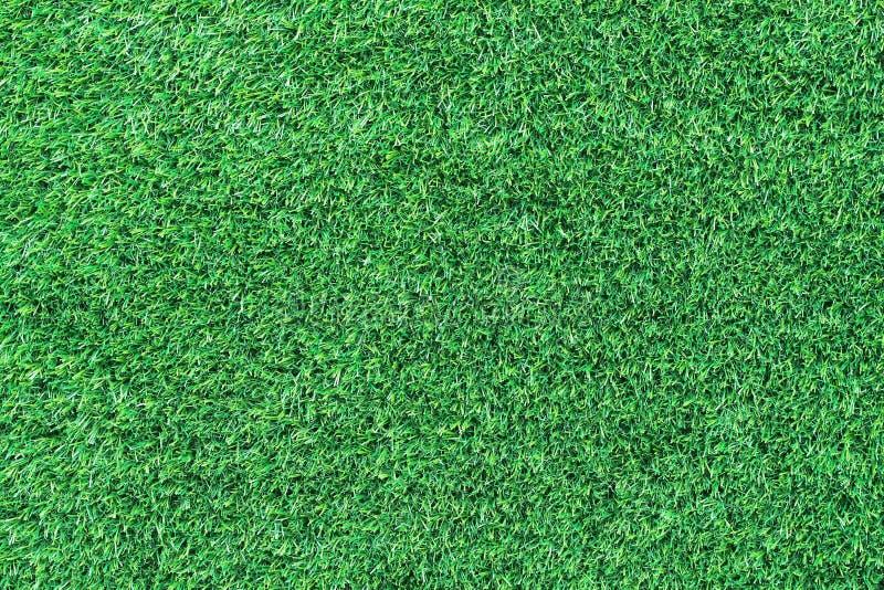 hierba verde artificial para el modelo y el fondo fotos de archivo