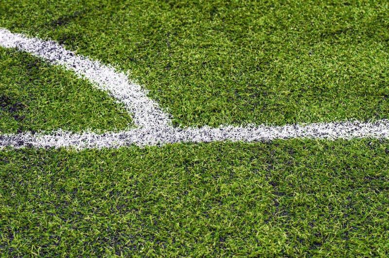 Hierba verde del césped del campo de fútbol para el propósito del fondo fotos de archivo libres de regalías