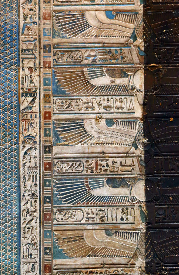 Hieroglyphic carvings in ancient egyptian temple stock
