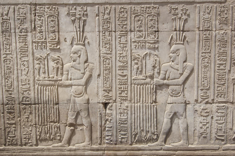 Hieroglyphic carvings on an egyptian temple wall royalty
