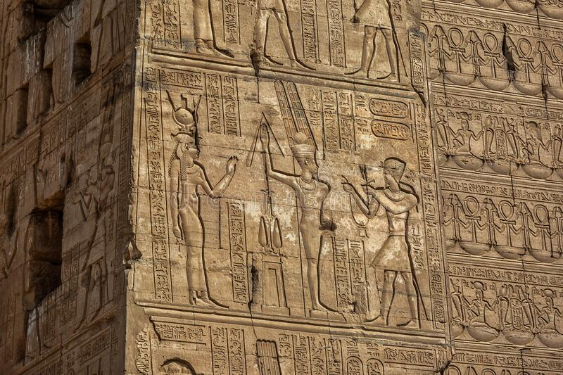 Hieroglyphic carvings in ancient temple royalty free stock photos