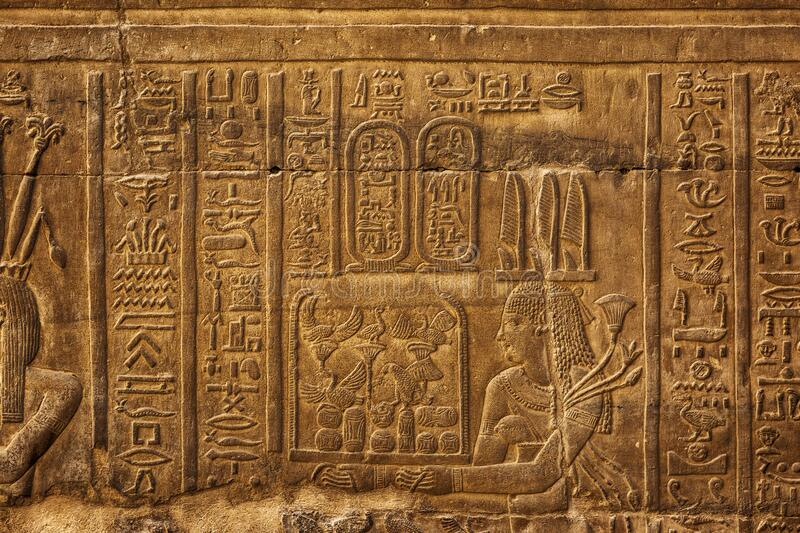 Hieroglyphic carvings in ancient temple royalty free stock photography