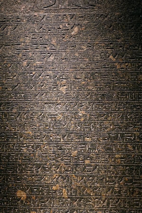 Hieroglyphics. Ancient Egyptian hieroglyphics carved on granite slabs on display at the British Museum of London stock image