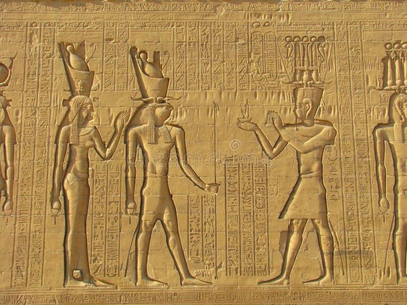 Hieroglyphics egipcios tallados piedra antigua foto de archivo