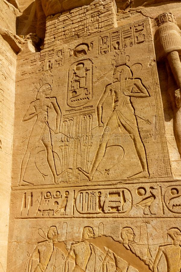 Hieroglyphics at the entrance of Abu Simbel. Hieroglyphics at the entrance of the Ramses II temple Abu Simbel royalty free stock photo