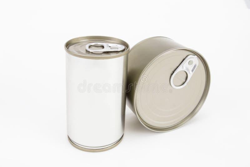 Hierro de oro ligero de la lata en el fondo blanco fotografía de archivo libre de regalías