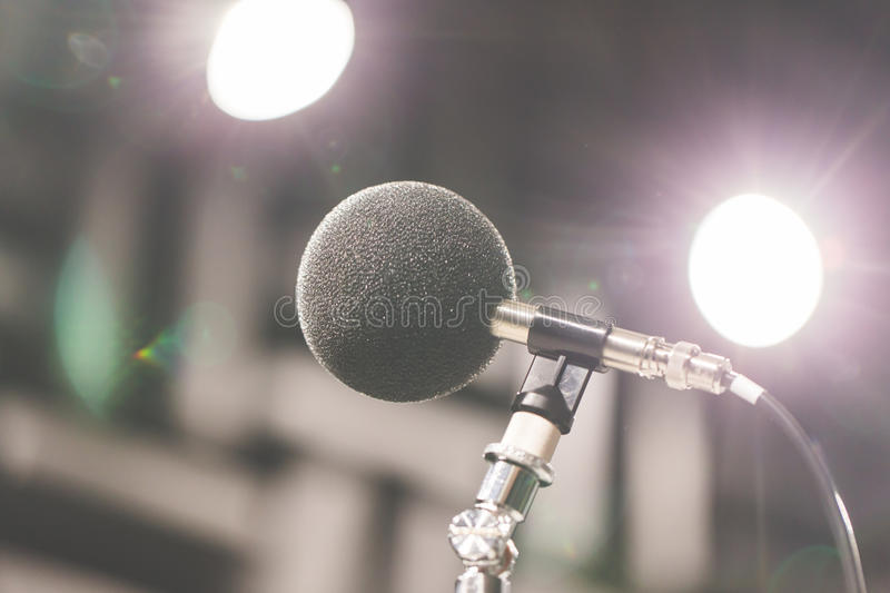 High accuracy microphone in noise sound testing room with LED light bokeh. High technology. Microphone for noise recorder. royalty free stock images