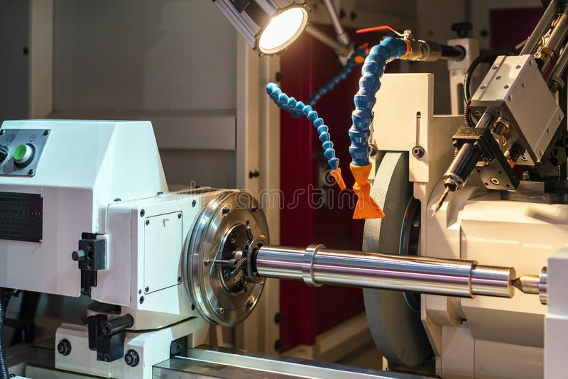 High accuracy surface cylindrical grinding machine of manufacturing finishing process for industrial metal work at factory.  royalty free stock photos