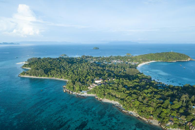 High aerial overview of entire tropical Lipe Island and Andman S. High aerial overview of entire tropical pe Island and Andman Sea in Satun province, Thailand royalty free stock photography
