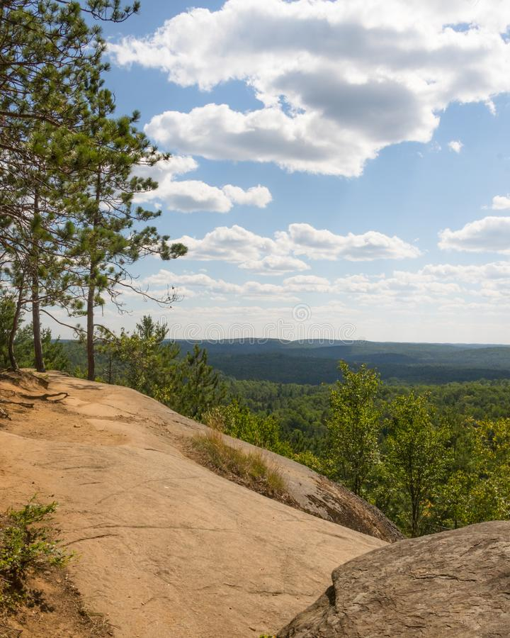 High in Algonquin Scene. Beautiful scene that awaits the hiker at top of Lookout Trail in Algonquin Provincial Park in Ontario Canada. Rock ridge, forest as far royalty free stock images