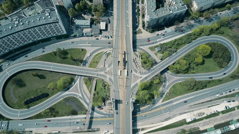 High altitude aerial shot of big urban road junction on a sunny day, top down view. High altitude aerial shot of big urban road junction on a sunny day royalty free stock photos