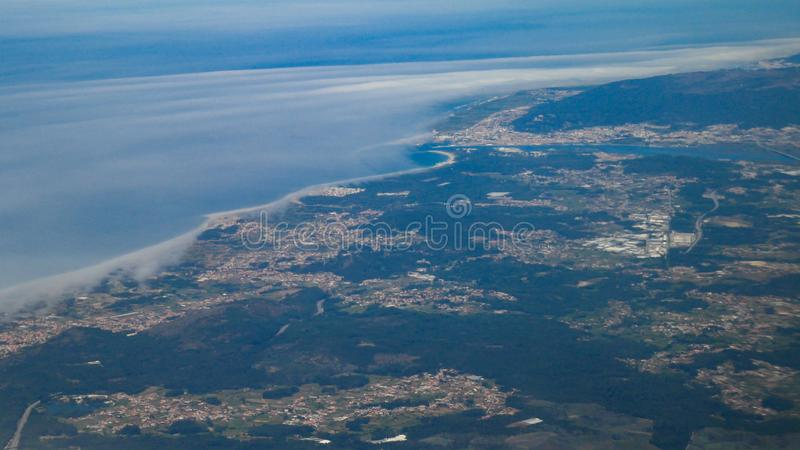 High altitude Aerial shot from plane over Viana do Castelo district in Portugal. Showing cities of Darque, Viana do Castelo and the Limia river royalty free stock photos