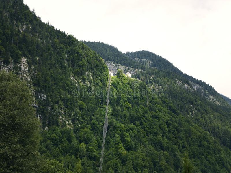 High-altitude cog railway, rail lift in Hallstatt. Mountain lake, Alpine massif, beautiful canyon in Austria. Salzburg Alpine valley in summer, clear water royalty free stock photo