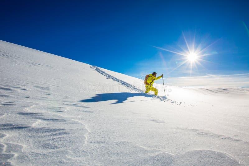 High altitude mountain explorer walking through deep snow stock image