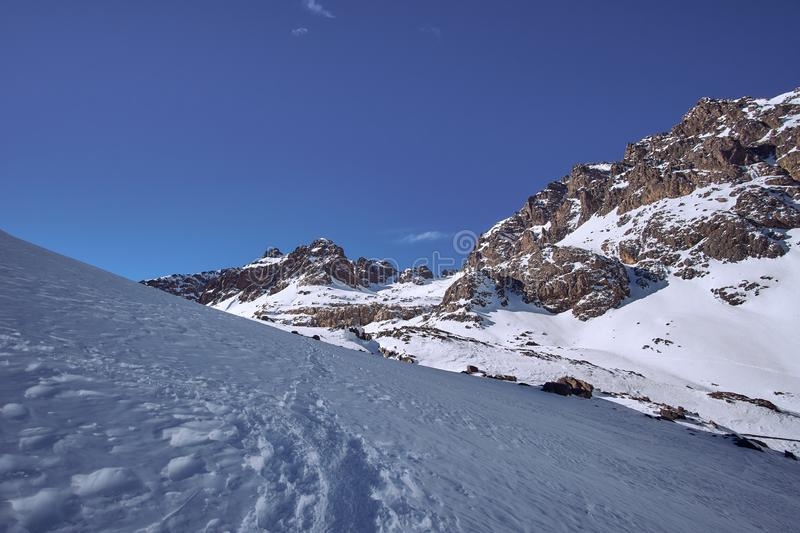 Hiking path to the top of Jebel Toubkal in winter royalty free stock images