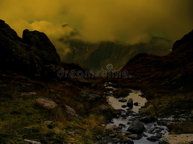 High altitude scenic mountain landscape with brook royalty free stock photography
