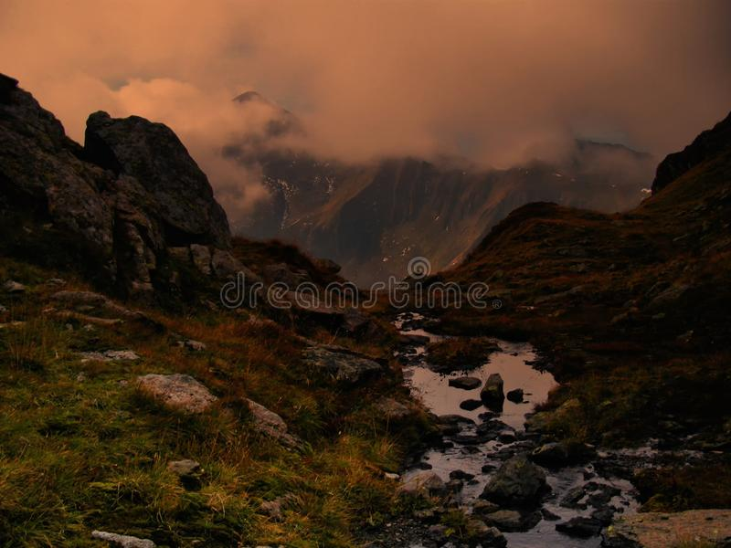 High altitude scenic mountain landscape with brook royalty free stock image