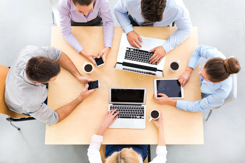 High angle of business people at table stock image