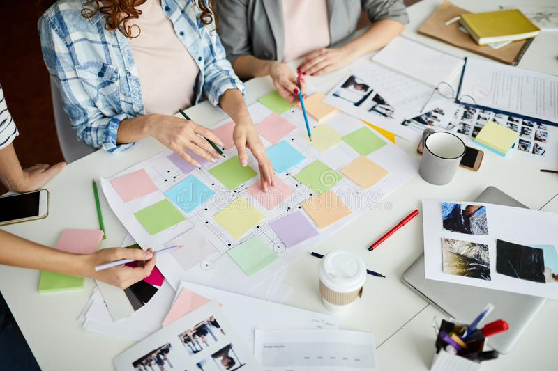 Roadmap Work. High angle closeup of contemporary business team planning project placing colorful stickers on roadmap, copy space royalty free stock photo