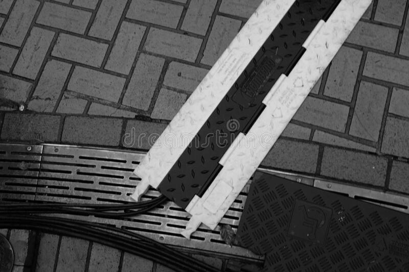 High angle greyscale shot of wires on the ground in Portland, United States. PORTLAND, UNITED STATES - Dec 14, 2019: A high angle greyscale shot of wires on the royalty free stock photo