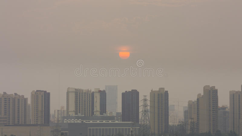 High angle horizontal building shot of sunset in beijing on a foggy day royalty free stock photo