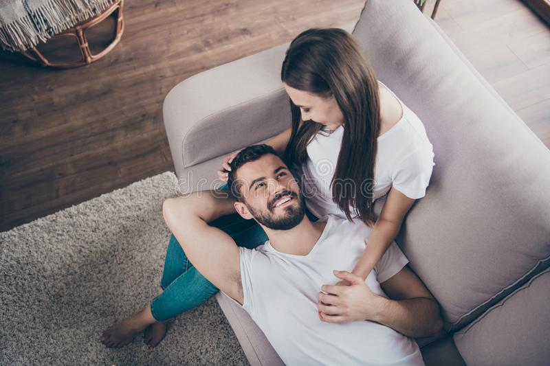 High angle photo of adorable pair in love relaxing together sitting cosy sofa indoors stock photos