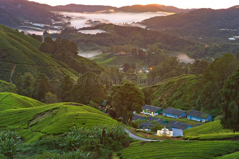 High Angle Photography of Village on Green Mountains royalty free stock images