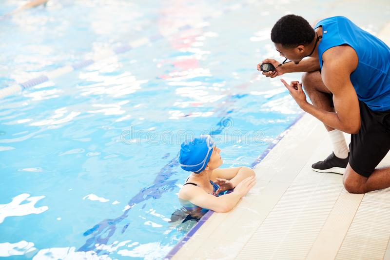 Woman Talking to Guard in Pool royalty free stock photo