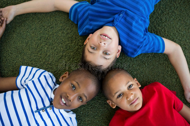 High angle portrait of children forming huddle. At park stock photos