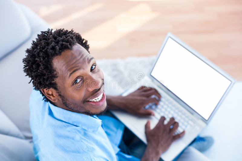 High angle portrait of man working on laptop. At home stock images