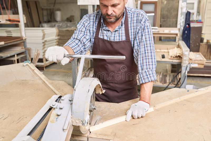 Carpenter Cutting Wood in Joinery royalty free stock photos