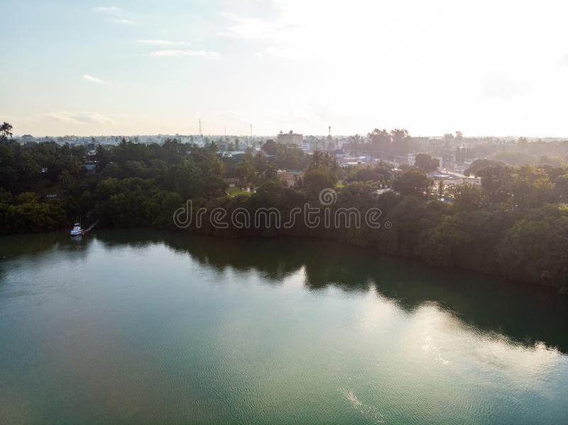 High angle shot of the blurred reflection of the trees in a lake captured in Mombasa, Kenya. A high angle shot of the blurred reflection of the trees in a lake stock image