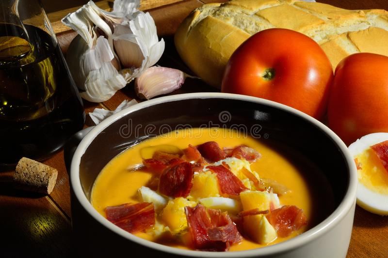 High-angle shot of a bowl with spanish salmorejo, a typical cold soup made with tomato, bread, olive oil and garlic, topped with royalty free stock image
