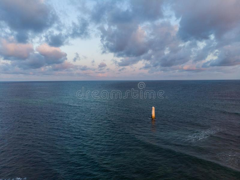 High angle shot of the calm ocean under the beautiful cloudy sky captured in Mombasa, Kenya. A high angle shot of the calm ocean under the beautiful cloudy sky stock photos
