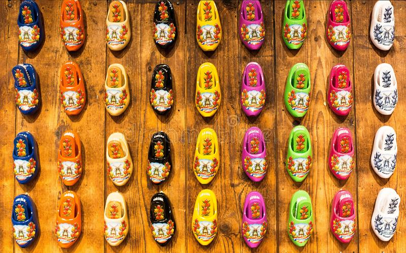 High angle shot of colorful decorative clog shoes on a wooden surface - great for a cool background royalty free stock images