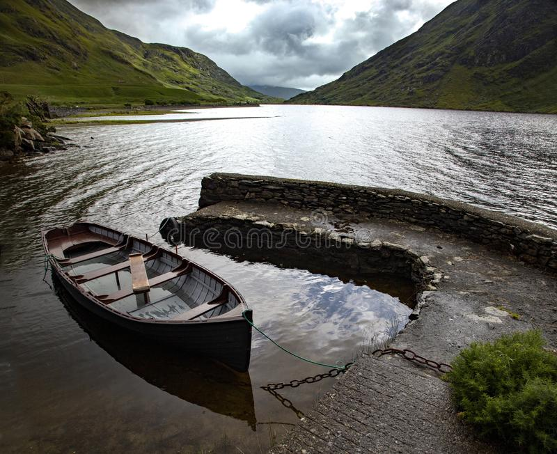High angle shot of an isolated rowling boat parked in the Doo Lough, County Mayo in Ireland. A high angle shot of an isolated rowling boat parked in the Doo stock photos